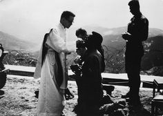 Paulist Fr. Kevin Devine sharing the Holy Eucharist at a Mass in Korea during his service as a U.S. Army chaplain.