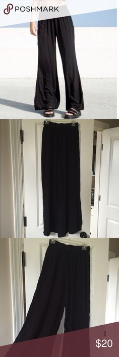 Brandy Melville black flowy pants Brandy Melville black flowy pants (Lizeth pants) with stretchy waist band. Super soft and comfortable and looks amazing with a crop top or sweater! Perfect condition! Worn once Brandy Melville Pants Wide Leg