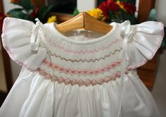 Notice that it is smocked in 2 layers--one at the top of the shoulder and the other finishing near under arm.