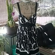Dress BEBE Nwot Blk &Wht summer dress w/ satin adjustable straps. Zips from the back, has Bebe logo throughout dress, slip attached underneath.  Perfect summer wear. bebe Dresses Midi