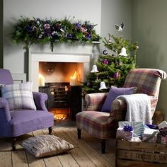 Cosy Christmas living room with heather armchairs | Country Christmas decorating ideas