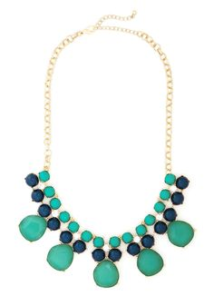 Just Add Shimmer Necklace. Accompany your pleated frock and peep-toe heels with an additional layer of dazzling style by fastening the oversized link chain of this beaded bib necklace around your neck! #green #modcloth