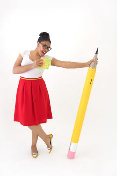 Transform a mail tube into a giant pencil piggybank.