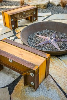 The benches by the fire pit were salvaged from the home's original steel beams.