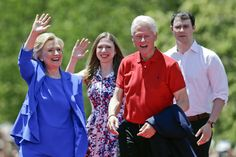 Democratic presidential candidate former Secretary of State Hillary Rodham Clinton waves to supporters as her husband former President Bill Clinton, second from right, Chelsea Clinton, second from left, and her husband Marc Mezvinsky, join on stage, June 13, 2015, on Roosevelt Island in New York.