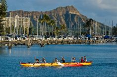 Outrigger canoe paddlers.  Oahu, Hawaii.  Diamond Head in the background.