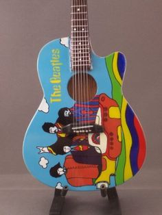 Mini Guitar BEATLES YELLOW SUBMARINE Acoustic Collectible by BEAT. $27.95. Mini Guitars are made with extreme attention to detail. Non-playable and perfect for display in homes, gamerooms, offices, etc... Order more than one item from our store and SAVE ON SHIPPING. Only $1.99 more for shipping per item.