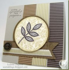card with a formal look in neutral colors...really like the attention to details...bands of striped papers with stripes at right angles adds a dynamic feel...