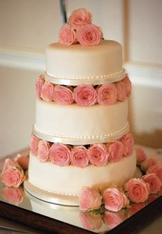 Traditional three-tiered cake with pink flowers