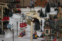Ski lift and chairs handcrafted from dollar store craft sticks and doweling