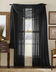 Black Sheer Curtain Scarf. Just put the scarf over the red curtains, and its perfect! :)