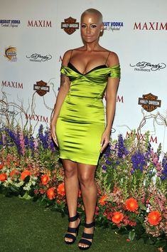 Elegantly ineffable excellence of Amber Rose ...Classy short hair cut... Rose is half Italian half Cape Verdean