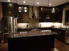 Espresso cabinets and grey brown granite countertops!  Love!