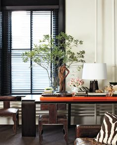 Great table scape.  Several Hermes orange trays laid side by side.