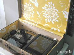 vintage suitcase upcycled to electronics charging station, repurposing upcycling, All filled up and ready to charge