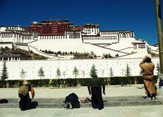 worshiping the potala palace, tibet
