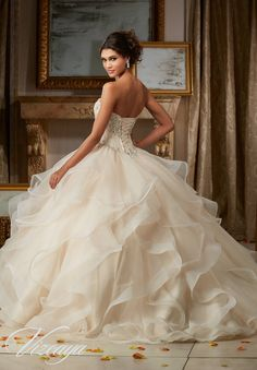 Quinceanera Dresses by Morilee designed by Madeline Gardner. Flounced Organza Quinceañera Dress featuring a Cascading Tiered Skirt with Horsehair Trim.