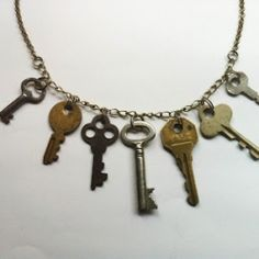 Using small vintage keys, create a statement necklace.