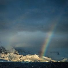 The long journey home after a visit to the Antarctic Peninsula rewards us with a rainbow on the Lemaire Channel.  The icebergs move like sculptures in the distance and as I stare into the darkening sky I am certain it is impossible to find a more desolate beautiful and mesmerizing landscape on this beautiful Earth of ours. With @paulnicklen  and @sea_legacy #explore #beauty #lastplaceonEarth by natgeotravel