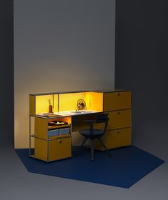 USM Haller E - Light fuels creativity - The golden yellow work and charging station boosts the energy in your home office. The barely visible lights embedded in the tubes infuse warm light into your everyday life. USB chargers ensure that all mobile devices are powered 24 hours a day. Lights and USB chargers can be disconnected and moved at any time. The interior is evenly illuminated as soon as the compartments and drop-down doors are opened.