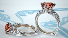 A winning design by Green Lake Jewelry Works' Shinya Takahashi featuring delicate yet easily cast filigree and a unique Padparadscha sapphire center