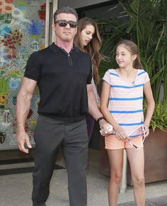 Sylvester Stallone cuddles up to his three girls during ...