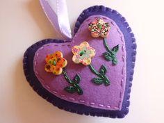 Handmade felt heart in dark purple with flower by Madeinthehoose