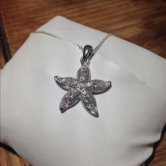 Sterling silver star necklace This is a beautiful sterling silver beachy necklace. Bought in Ocean City MD. The stones shine all different colors in the sun. Necklace 18 inches long. Jewelry Necklaces