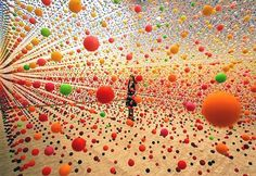 Atomic: Full of Love, Full of Wonder was a 2005 installation by artist Nike Savvas at the Australian Centre for Contemporary Art in Melbourne. The piece involved an immense array of suspended bouncy balls creating a dense field of color in the gallery space that was gently moved in waves by a nearby fan. http://media-cache8.pinterest.com/upload/224687468879366953_p09pKyQp_f.jpg jdraper installation