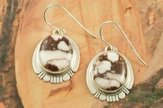 Stunning Earrings feature Genuine Wild Horse Stones set in Sterling Silver French Wire Earrings. Created by Navajo Artist Phillip Sanchez.