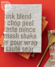 Cover a cookbook (a new release or an old favourite) with a tea towel and secure to the inside with double-sided tape. Top off the gift with a wooden kitchen accessory.