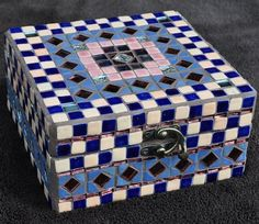 Create this mosaic jewellery box using ceramic tiles and mirrrors. A great craft project.