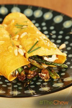 Dig in to these delicious vegetarian Asparagus, Mushroom & Goat Cheese Enchiladas with Pine Nut Mole Sauce!