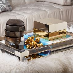 """A Stylish Tray - """"I'm partial to our Jacques tray—it's the perfect finishing touch. The mirror and acrylic feel light and refreshing, like lemon sorbet for the home,"""" Adler says. """"We all know your table becomes a catchall for remotes, coasters and candles—might as well corral it all in style."""" Amen."""