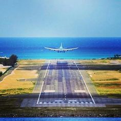 A KLM B747-400 landing at St. Maarten Airport as viewed from the other end of the runway.