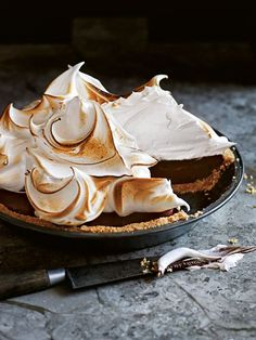 S'mores chocolate meringue pie. Crunchy biscuits, smooth dark chocolate and airy meringue make this dessert a…