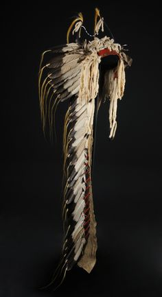 Horn bonnet with ermine and feathers on cap with full trailer with thirty-one eagle feathers.  Mandan, ca.1830-1840