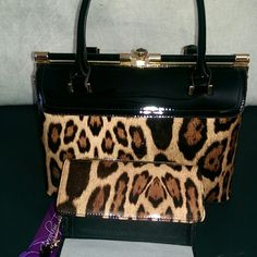 """New satchel bag Carolyn Tucker safari faux-patent leather with gold tone hardware and clasp-lock closure. This bag has a removable adjustable strap 21.5"""" drop. Get on the wild side with this elegant exotic bag. 12""""x 9""""x 6"""" with matching wallet Carolyn Tucker Bags Satchels"""