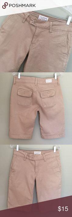 Levi Strauss khaki shorts  Levi Strauss khaki shorts. Heavier denim style longer shorts. Very good condition. Size 8 Levi Strauss Shorts