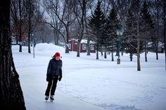 Skating at Pointe Merry in Magog - Woman skating at Pointe Merry in Magog QC, Canada. Alongside lake Memphremagog.