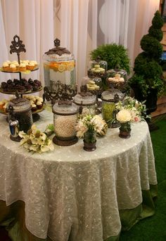 Gold pumpkins, live moss table runner & french macaroons featured in the Rustic Glam Tablescape at Enchanted Bridal Show