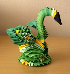 Small Green Swan (3D Origami) | There are many types of Origami Artwork for example wet-folding, action origami, Modular origami, Pureland origam, origami tessellations, Kirigami, mathematical origami, technical origami etc. Here are 30+ stunning Origami Artwork that's fun but not easy
