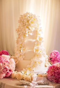 Brides: Elegant Five-Tiered Wedding Cake. This five-tiered wedding cake, by Vanilla Pastry Studio, looks as good as it tastes: It's filled with layers of chocolate cake paired with chocolate buttercream and vanilla bean cake and raspberry buttercream and jam.