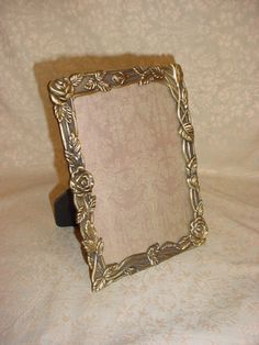 Beautiful photo frame with roses by Weston