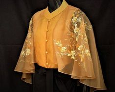 Modern filipiniana inspired silk hand-painted cape blouse philippine national co Stylish Blouse Design, Fancy Blouse Designs, Sari Blouse Designs, Blouse Patterns, Skirt Patterns, Coat Patterns, Sewing Patterns, Modern Filipiniana Dress, Mode Hijab