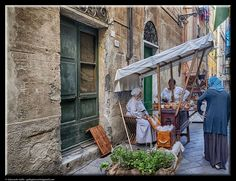 In the street by Giancarlo Gallo
