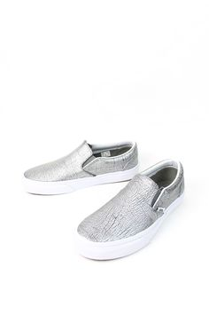 Vans The Foil Metallic Classic Slip-On features low profile slip-on leather uppers, padded collars, elastic side accents, and signature waffle outsoles. - Style# VN-0003DVHTI - Color: Silver/True Whit