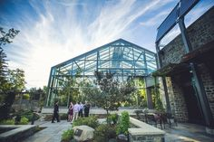 Calgary Zoo Butterfly Conservatory at dusk sunset wedding in the summer glass building pointed architecture. Calgary wedding photographer