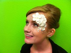 Create a beautiful and unique look buy using lash glue to attach flowers to your face. This look was created by Jenni brown at Paul Mitchell The School Colorado Springs.