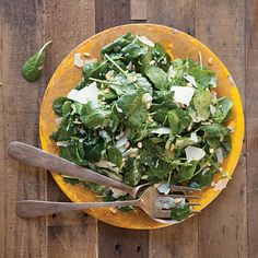 This quick, zesty kale salad from Florida chef Jeffery Jew gets a decadent touch from rich pine nuts and ribbons of parmesan cheese.